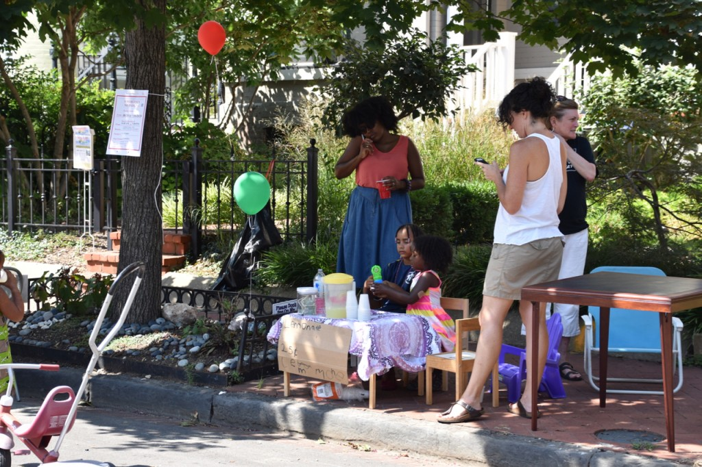 Enterprising residents sell lemonade.